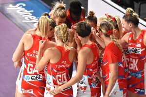 NSW Swifts huddle during the 2020 SSN season.