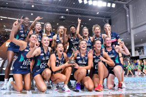 The Melbourne Vixens holding 2020 SSN trophy