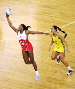 Pam Cookey playing netball for English Roses vs Mo'onia Gerrard of Australia
